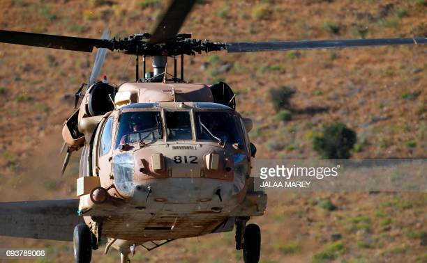A picture taken on June 8 2017 shows an Israeli military helicopter carrying US Ambassador to the United Nations Nikki Haley landing in the...