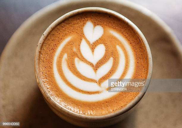 A picture taken on June 8 2018 shows a prepared cup of coffee at the 'Flat White' cafe in the Qatari capital Doha's Tawar Mall Tawar Mall looks like...