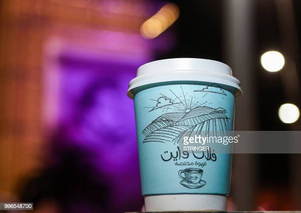 A picture taken on June 8 2018 shows one of the plastic coffee cups of the 'Flat White' cafe in the Qatari capital Doha's Tawar Mall Tawar Mall looks...