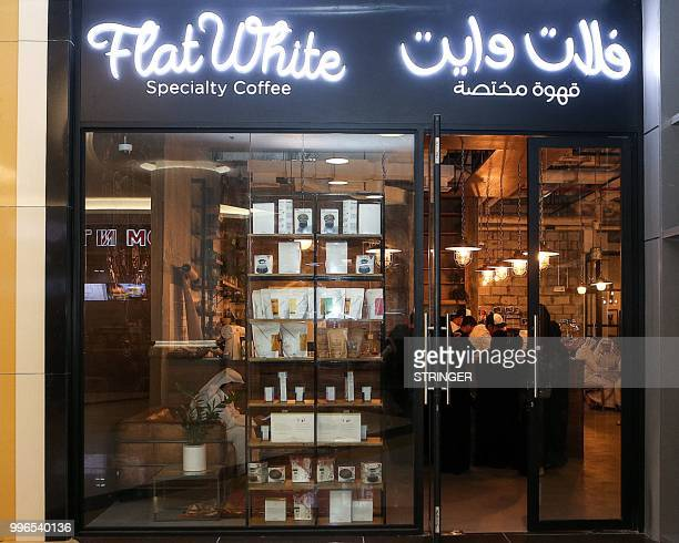 A picture taken on June 8 2018 shows the exterior of the 'Flat White' cafe with its neonlit sign in the Qatari capital Doha's Tawar Mall Tawar Mall...