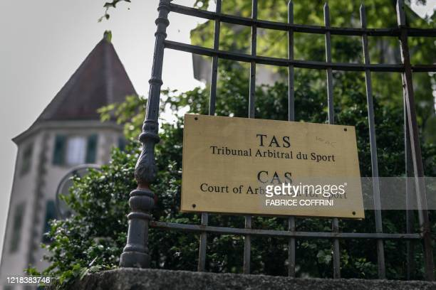 Picture taken on June 8, 2020 shows a sign at the entrance of the Court of Arbitration for Sport in Lausanne on the opening day of an appeal by...
