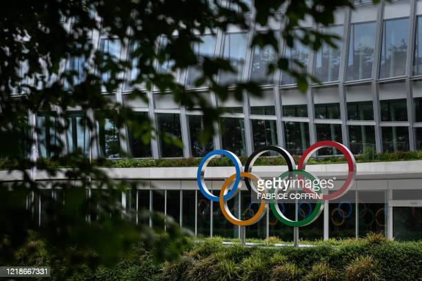 Picture taken on June 8, 2020 shows the Olympic rings logo at the entrance of the headquarters of the International Olympic Committee in Lausanne...