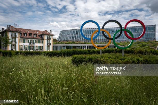 Picture taken on June 8, 2020 shows the Olympic rings logo in front of the headquarters of the International Olympic Committee in Lausanne amid the...