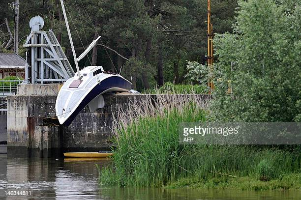 A picture taken on June 9 2012 in Le Pellerin western France shows the work by Austrian artist Erwin Wurm 'Le bateau mou' one of the nine works of...