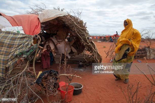 A picture taken on June 9 2017 shows people displaced by Ethiopia's drought going about with their daily life at a displaced persons camp in Werder...