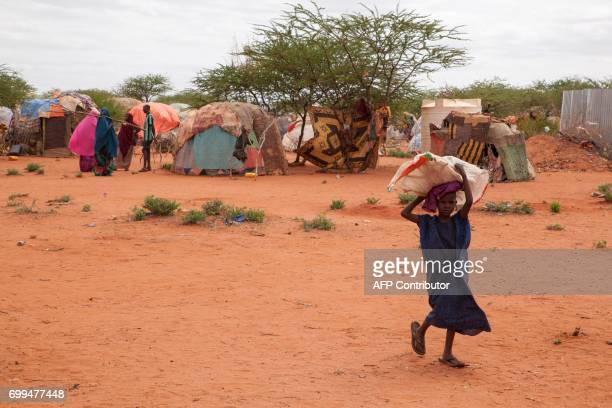 A picture taken on June 9 in Wender shows a child carrying a bag in a displaced persons camp due to Ethiopia's drought The Somali people of...