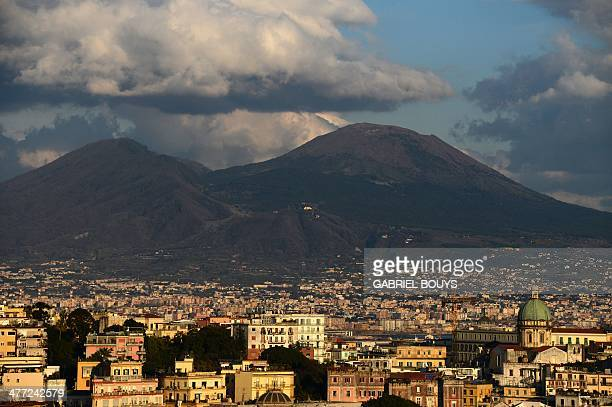 A picture taken on March 07 2014 shows a view of Naples and the Mount Vesuvius AFP PHOTO / GABRIEL BOUYS