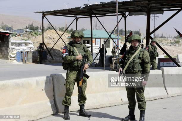 Picture taken on March 1, 2018 shows members of the Russian military police standing guard at the Wafideen checkpoint on the outskirts of Damascus...