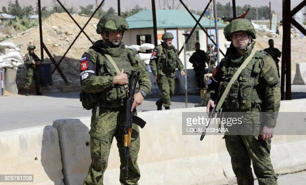 A picture taken on March 1 2018 shows members of the Russian military police standing guard at the Wafideen checkpoint on the outskirts of Damascus...