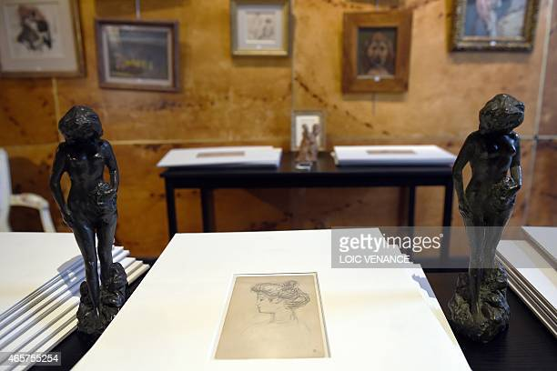 A picture taken on March 10 2015 shows a Jeune fille nue debout a bronze by French artist Pierre Bonnard and the drawing Misia de profil which will...