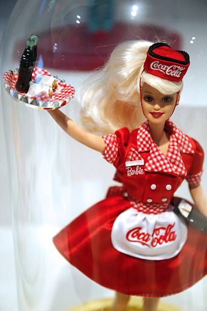 a picture taken on march 10 2016 shows a barbie doll wearing a coca