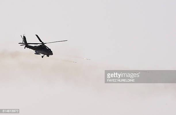 A picture taken on March 10 2016 shows an apache helicopter firing during the Northern Thunder military exercises in Hafr alBatin 500 kilometres...