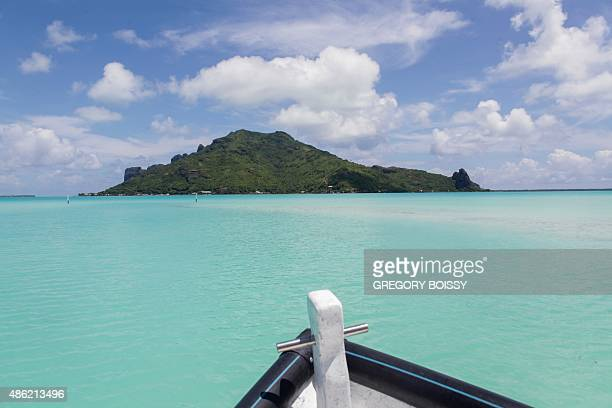A picture taken on March 11 2015 shows a boat on a lagoon on the Maupiti island In 2010 the mayor of a French Polynesia atoll worried by the rising...