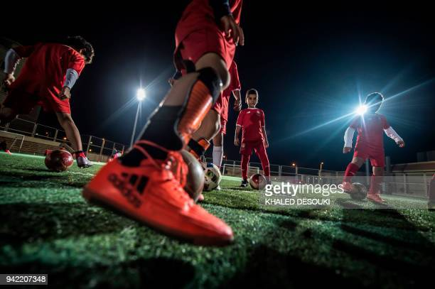 A picture taken on March 11 2018 shows Egyptian boys taking part in a training session at the Liverpool International Academy in the modern new city...