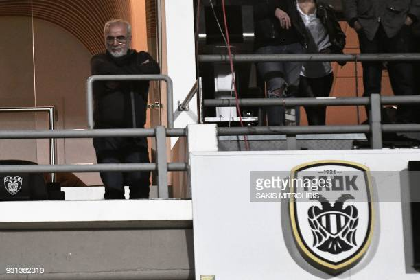 A picture taken on March 11 shows PAOK's GreekRussian president Ivan Savvidis watching the Greek Superleague football match between PAOK Thessaloniki...