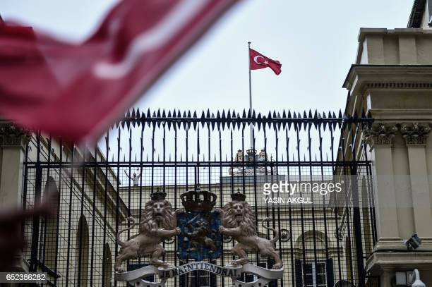 A picture taken on March 12 2017 in Istanbul shows a Turkish flag fluttering at the Dutch Consulate after protesters replaced briefly the...
