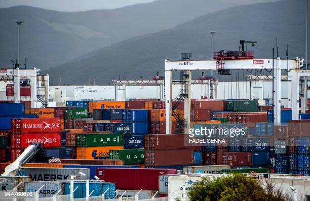 A picture taken on March 12 2018 shows a freight ship moored by cranes at the TangerMed container port and Renault terminal in Ksar Sghir near the...