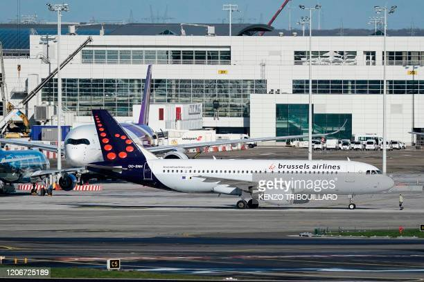 A picture taken on March 12 2020 shows a Brussels Airlines commercial plane at Brussels Airport in Zaventem outside Brussels