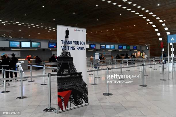 Picture taken on March 12, 2020 shows empty Delta Airlines check-in desk at Paris-Charles-de-Gaulle airport after a US 30-day ban on travel from...