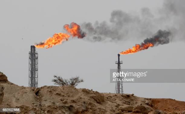A picture taken on March 12 shows a view of an oil facility in the Khark Island on the shore of the Gulf / AFP PHOTO / ATTA KENARE