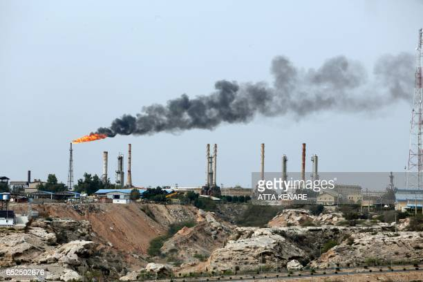 A picture taken on March 12 shows an oil facility in the Khark Island on the shore of the Gulf / AFP PHOTO / ATTA KENARE