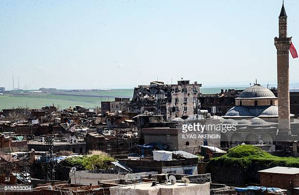 A picture taken on March 13 2016 shows buildings destroyed by the clashes in the Sur district of Diyarbakir on March 13 2016 Turkey on March 13 eased...