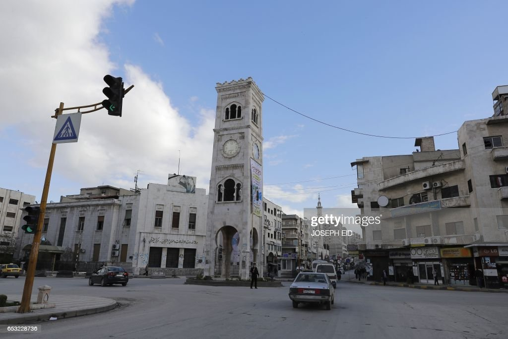 A picture taken on March 13, 2017 shows a general view of the main square of the city of Hama in central Syria. /