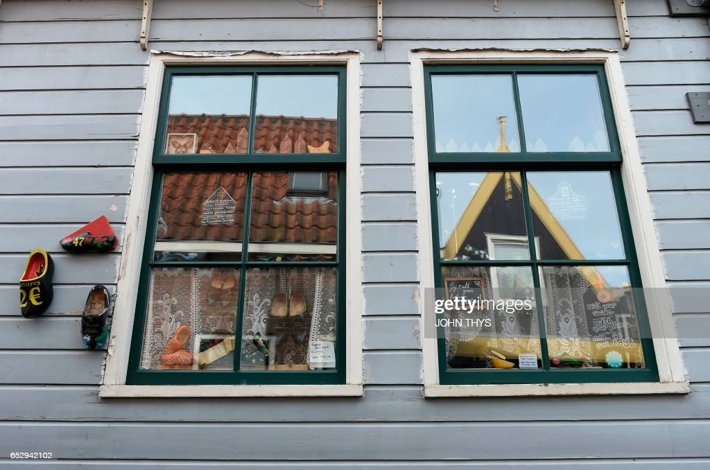 A picture taken on March 13, 2017 shows the windows of a house in the town of Volendam in The Netherlands