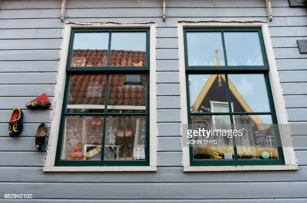 A picture taken on March 13 2017 shows the windows of a house in the town of Volendam in The Netherlands / AFP PHOTO / JOHN THYS