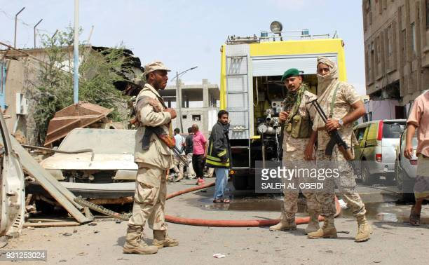A picture taken on March 13 2018 in the southern Yemeni city and government bastion of Aden shows government soldiers at the scene of an explosion...