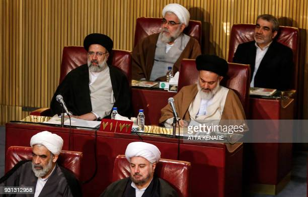 A picture taken on March 13 2018 shows Iranian cleric and current custodian and chairman of Astan Quds Razavi Ebrahim Raisi attending a session of...