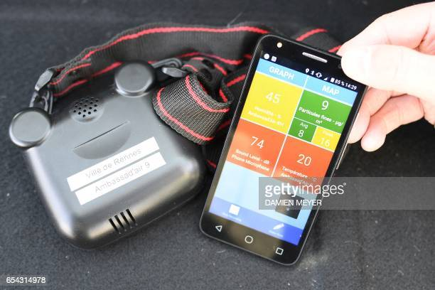 A picture taken on March 13 in the western city of Rennes shows a smartphone connected to a sensor measuring air quality a kit that will be used by...