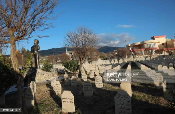 Picture taken on March 13 shows the graves of the victims of the 1988 Halabja Chemical attack in the Kurdish town, 300 kms northeast of Baghdad. - In...