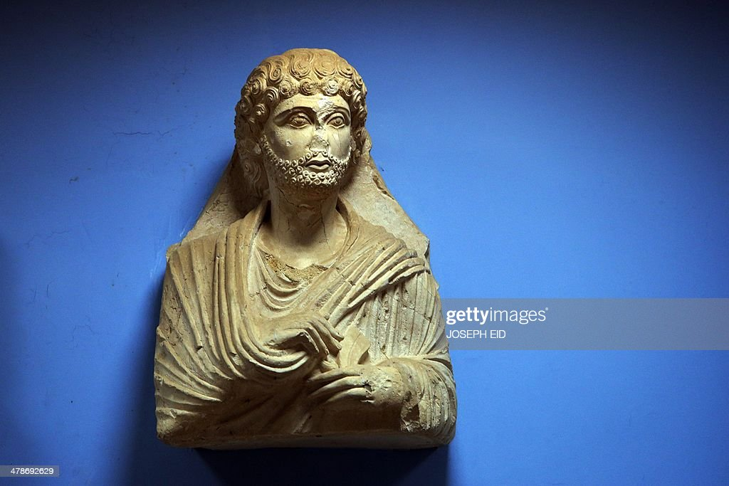 A picture taken on March 14, 2014 shows a sculpture found in the ancient Syrian oasis city of Palmyra, 215 kilometres northeast of Damascus, and now displayed at the city's museum. From the 1st to the 2nd century, the art and architecture of Palmyra, standing at the crossroads of several civilizations, married Graeco-Roman techniques with local traditions and Persian influences.