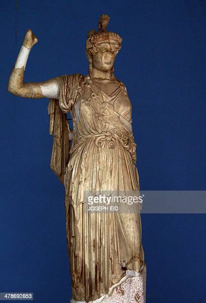 A picture taken on March 14 2014 shows a sculpture of the Greek deity Athina displayed at the ancient Syrian oasis city of Palmyr's museum 215...