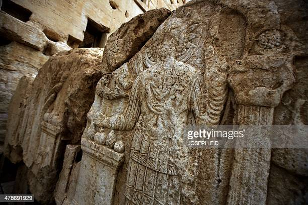 Picture taken on March 14, 2014 shows carvings on a wall in the courtyard of the sanctury of Baal in the ancient oasis city of Palmyra, 215...