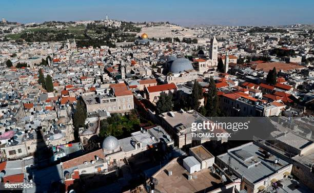 A picture taken on March 14 2018 shows a general view of the Dome of the Rock the Church of the Holy Sepulchre with its two grey domes and the Mount...