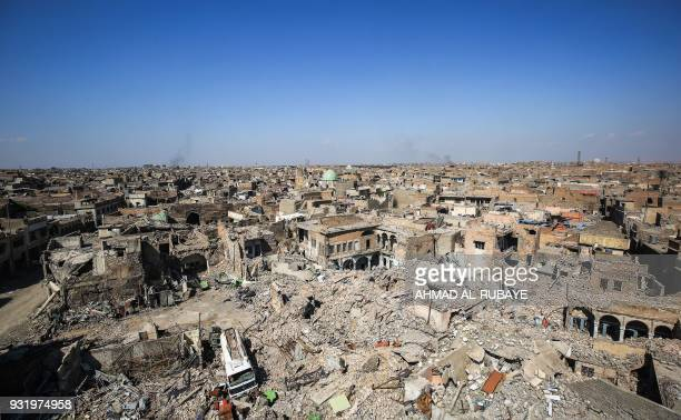 TOPSHOT A picture taken on March 14 2018 shows a view of destruction in the former residential area around the Nuri mosque in the old city of Mosul...