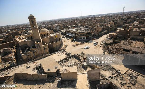 Picture taken on March 14, 2018 shows a view of destruction surrounding the Roman Catholic Church of Our Lady of the Hour in the old city of Mosul,...