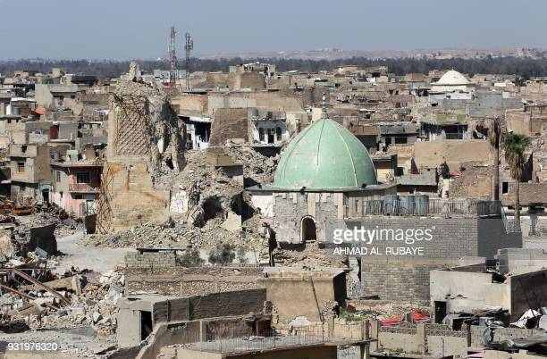 A picture taken on March 14 2018 shows a view of the dome of the destroyed Nuri mosque in the old city of Mosul eight months after it was retaken by...