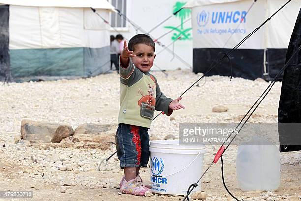 A picture taken on March 15 2014 shows a child at the sprawling desert Zaatari refugee camp in northern Jordan near the border with Syria which...