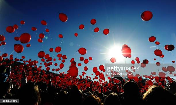 A picture taken on March 15 2015 shows people releasing red balloons during a flashmob at St Petersburg's Palace square AFP PHOTO / OLGA MALTSEVA