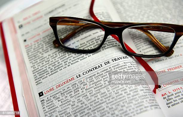 A picture taken on March 15 2016 shows a French labour code book in Paris The French government presented a watereddown version of its contested...
