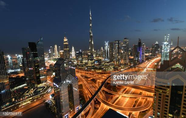 A picture taken on March 15 shows a general view of Dubai No shisha pipe sessions deserted streets mosques and shopping malls drones in the sky...
