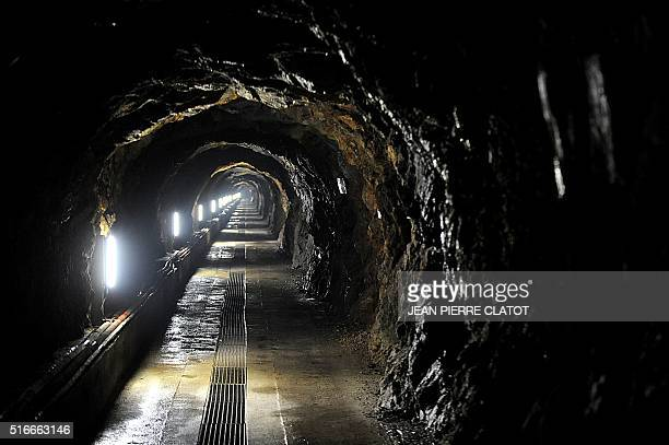 Picture taken on March 16, 2016 shows a long gallery dig in the rock leading to a vast ice cavity under the French energy giant EDF power plant La...