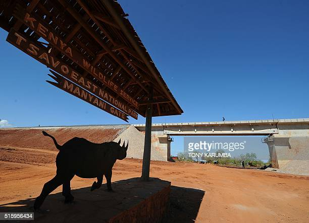 A picture taken on March 16 2016 shows a sign at the entrance of the Tsavo east national park of capital Nairobi / AFP / TONY KARUMBA