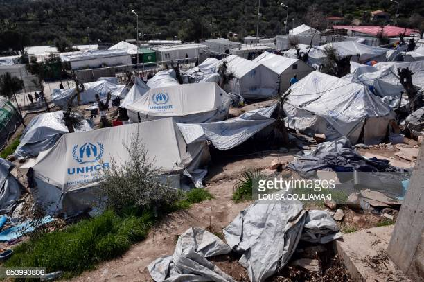 A picture taken on March 16 2017 shows the Moria migrant camp on the island of Lesbos almost a year after an EUTurkey deal The deal signed on March...
