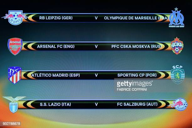 A picture taken on March 16 2018 shows a screen displaying the fixtures after the draw for the quarter finals round of the UEFA Europa League...