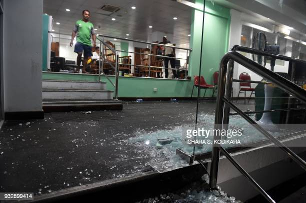 A picture taken on March 16 2018 shows damages after celebrations by the Bangladesh cricket team pavilion after scoring the winning run to defeat Sri...