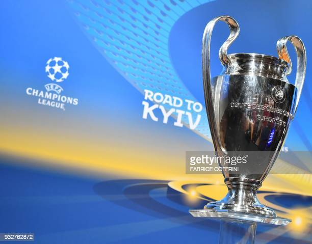 A picture taken on March 16 2018 shows the UEFA Champions League football cup during the draw for the quarter finals round of the UEFA Champions...